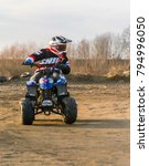 Small photo of Biskupice Radlowskie, Poland - January 14, 2018: Young adept steering training a ride on a small quad.