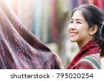 happy asian traditional woman... | Shutterstock . vector #795020254