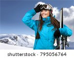woman carrying skis | Shutterstock . vector #795056764