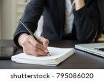 woman working paper work...   Shutterstock . vector #795086020