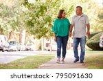 senior couple walking along... | Shutterstock . vector #795091630