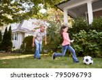 grandfather playing soccer in... | Shutterstock . vector #795096793