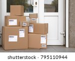delivered parcels on floor near ... | Shutterstock . vector #795110944