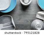 ceramic tableware on grey... | Shutterstock . vector #795121828