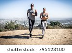 couple running in los angeles... | Shutterstock . vector #795123100