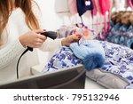 seller holding barcode scanner... | Shutterstock . vector #795132946