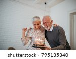 mature couple celebrating... | Shutterstock . vector #795135340