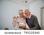 mature couple celebrating... | Shutterstock . vector #795135340