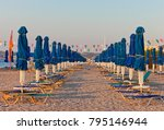 rows of sun loungers and... | Shutterstock . vector #795146944