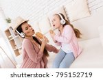 mom and daughter sing songs at... | Shutterstock . vector #795152719