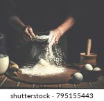 man preparing bread dough on... | Shutterstock . vector #795155443