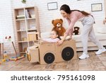 a little girl with her mother... | Shutterstock . vector #795161098