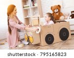 a little girl with her mother... | Shutterstock . vector #795165823