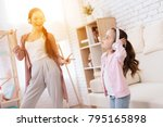 mom and daughter sing songs at... | Shutterstock . vector #795165898