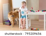 happy child with dog at home.... | Shutterstock . vector #795209656