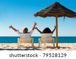 couple sitting in sun chairs... | Shutterstock . vector #79528129