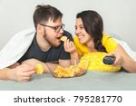 woman feed man with chips while ... | Shutterstock . vector #795281770