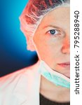 Small photo of Female allergist immunologist half face portrait, healthcare professional wearing protective mask