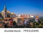 church above hillside homes in... | Shutterstock . vector #795310390