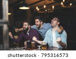 men at the pub watcing football ... | Shutterstock . vector #795316573