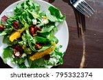 overhead of arugula salad on... | Shutterstock . vector #795332374