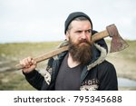 lumberjack in the woods with an ... | Shutterstock . vector #795345688