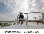 female worker inspection visual ... | Shutterstock . vector #795368128