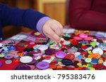 child's hands with button... | Shutterstock . vector #795383476
