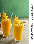 tropical mango smoothie with... | Shutterstock . vector #795385660