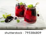 cold summer berry drink with... | Shutterstock . vector #795386809