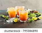 spicy tequila sunrise margarita ... | Shutterstock . vector #795386890