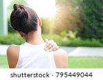 women have neck pain  shoulder...   Shutterstock . vector #795449044