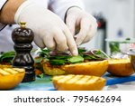 the chef prepares a burger with ...   Shutterstock . vector #795462694