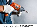 man with electric drill | Shutterstock . vector #795474370