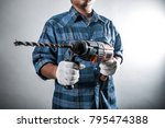 man with electric drill | Shutterstock . vector #795474388