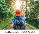 traveler with backpack in green ... | Shutterstock . vector #795479506