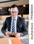 asian businessman working on... | Shutterstock . vector #795480004