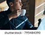 business man with a mug of... | Shutterstock . vector #795484390