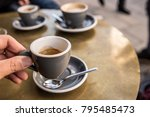 espresso and water on a table... | Shutterstock . vector #795485473