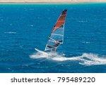 windsurfer on a board under a... | Shutterstock . vector #795489220