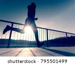 rear view to runner in blue t... | Shutterstock . vector #795501499
