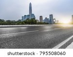 empty asphalt road with city... | Shutterstock . vector #795508060