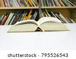 open book on the table | Shutterstock . vector #795526543