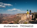 tourists with backpack hiking... | Shutterstock . vector #795546010