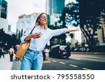 smiling female traveler in... | Shutterstock . vector #795558550