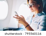 attractive female passenger of... | Shutterstock . vector #795560116