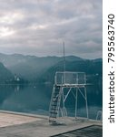 Small photo of Empty beach. Beautiful view of lake Bled with empty beach. Amazing pastel colours. Solitude concept.
