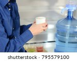 man in blue shirt holding cup... | Shutterstock . vector #795579100