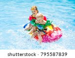 boy and girl on inflatable ice... | Shutterstock . vector #795587839
