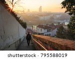 a man walking down the stairs... | Shutterstock . vector #795588019
